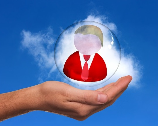 A picture of an outstretched hand with a bubble floating above it. Inside the bubble is a cartoon image of a person's head and shoulders, wearing a red jacket and tie.